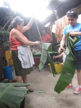 Alina and her mom cutting the leaves for the nacatamales.