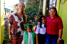 """Graduation day with my host sisters Belenia (graduating pre-school), Sinai (graduation primary/6th grade), and their mom Magdalena."" - Alba"