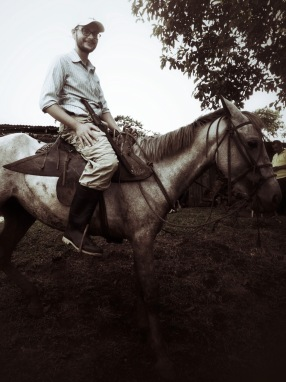 Tim on a horse after 1 1/2 ride to a rural community to do a training.