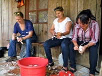 Kari helping teachers peel yucca at the farm on Nicaragua's Independence Day