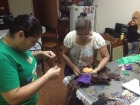 Ana Cecilia and Nidia sewing the pants.